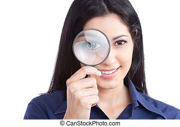 Woman Holding Magnifying Glass - Happy young woman looking...