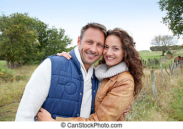 Closeup of happy couple in autumn