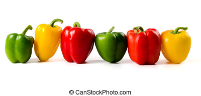 A lineup of colored peppers - Green,red and yellow peppers...