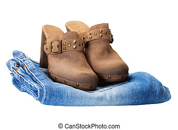 boots in jeans isolated over white background