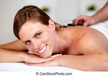Relaxed girl receiving a massage at spa - Close up portrait...