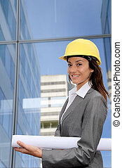 Woman engineer in front of modern building