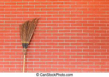 broom on brick wall - broom on red brick wall