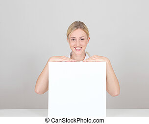 Smiling woman showing message board