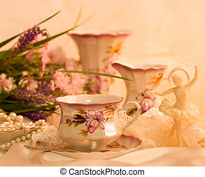 Vintage tea in elegant cups and flowers