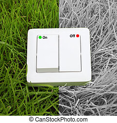 light switch on a green grass background