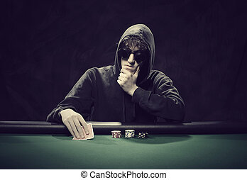 tough decision - Portrait of a professional poker player...