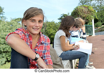 Teenagers studying outside the class