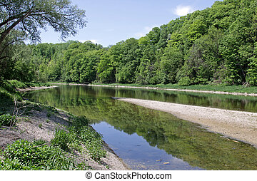 Grand River Reflections - The reflection of the tree-line in...