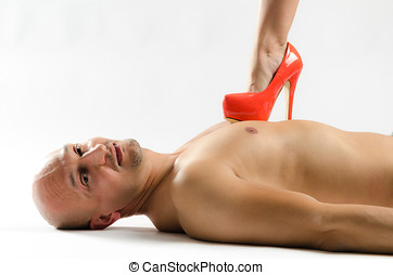 Naked man being stepped on - A naked man lying on the floor...
