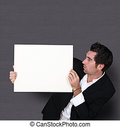 Funny salesman holding whiteboard
