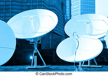 parabolic satellite dish receivers - blue toned picture of...