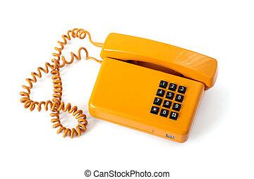 Old phone - Old orange telephone isolated on white...