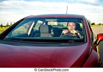 Drunk man driving a car