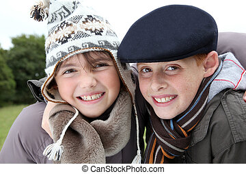 Brother and sister wearing hat in winter