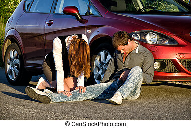 Woman and man on a road. Concept car accident