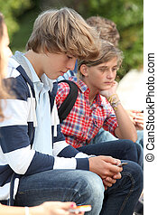Teenaged boy with mobile phone