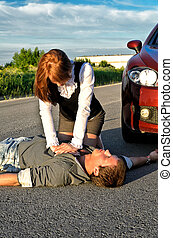 Young man reanimation on a road. Concept first aid