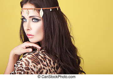 Exotic woman wearing a headband around her lovely wavy...