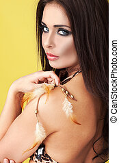 Seductive woman with feathers - Seductive woman with...