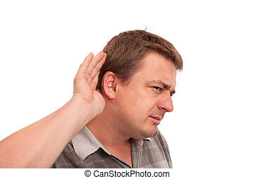 I can't hear you - Middle aged deaf man wearing hearing aids cupping hand behind ear on white background