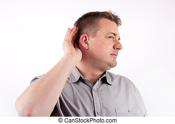 Man wearing hearing aid trying to hear