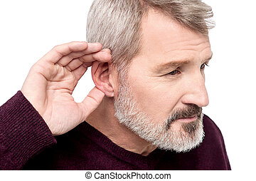 Can't hear you, what did you say ? - Mature man cupping his...