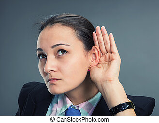 Can't hear - Young caucasian businesswoman try to hear...