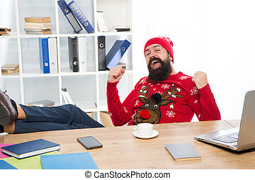 Cant think about work. Happy manager enjoy holiday atmosphere at work. Bearded man celebrate holidays during work day. Break at work. Winter holidays or vacation. Christmas and new year eve