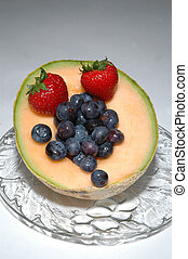 cantaloupe, blueberries and strawberries