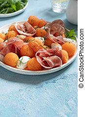 Cantaloupe melon salad with mozzarella and ham