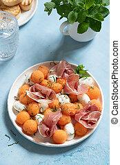 Cantaloupe melon salad with mozzarella and prosciutto
