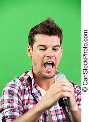 cantante, parete, compiendo, contro, verde, maschio