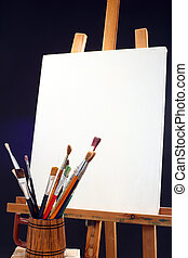 canvas, brushes and easel