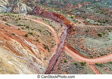 canyon road and creek - aerial view