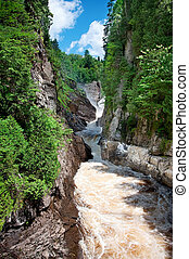 Canyon Sainte-Anne in St-Joachim, Quebec, Canada near Ste-Anne de Beaupre. A 74 meter high waterfall is rumbling into a small canyon.