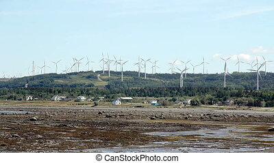 Cap-Chat hill wind turbines footage in real time at summer...