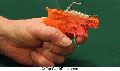 cap gun - shooting a child's plastic toy cap gun