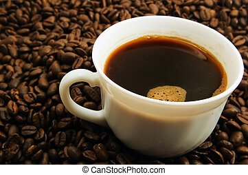 Cap of coffee on coffee bean background