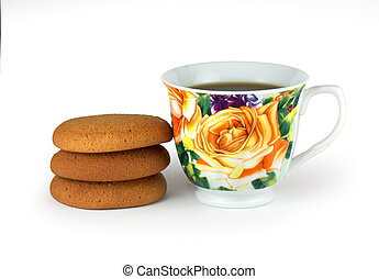 cap of tea and biscuit