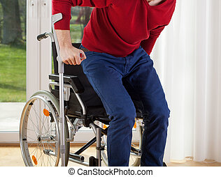 Capable disabled trying to get up from the wheelchair