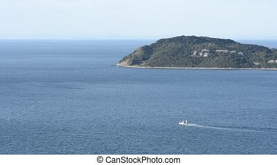 Cape and boat - Cape and going boat on a sea in Awaji island