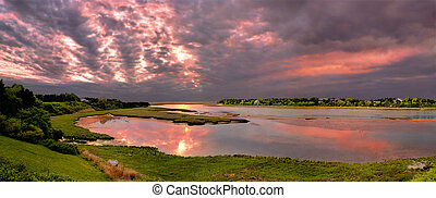 Sunrise over the tidal flats in Cape Cod, Massachusetts.
