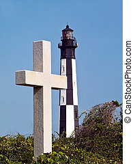 "Cross marks spot Jamestown settlers came ashore and ""New"" Cape Henry Lighthouse symbolically juxtaposed"