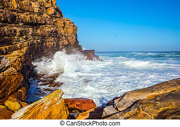 Cape of Good Hope - The raging ocean and blue sky in the...