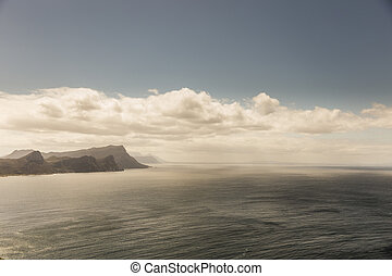 Cape of Good Hope, with a blue sky and some clouds.