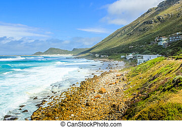Scenic landscape of the Atlantic coast. Scarborough village in Cape Peninsula, South Africa. Scenic drive, main road to Cape of Good Hope.
