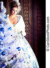 cape - Portrait of the elegant woman posing with Christmas ...