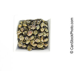 Capers - Macro photograph of salted capers on a white ...