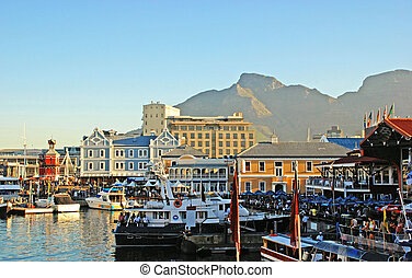 CAPE TOWN, SOUTH AFRICA - DECEMBER 29: Victoria and Alfred Waterfront, harbor with recreation boats, shops, restaurants and Table Mountain on the background at December 29, 2007 in Cape Town, South Africa. The Cape Town Waterfront is officially known as the Victoria & Alfred Waterfront, or the V&A ...